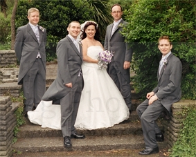 bride groom best man and ushers strike an elegantly formal pose weddin photography in south wales